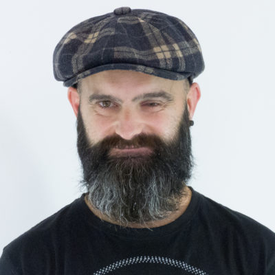 newsboy cap in purple tartan wool